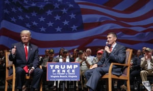 Then-presidential candidate Donald Trump gives a thumbs up as he speaks with Michael Flynn during a town hall in 2016 in Virginia Beach. (AP Photo/Evan Vucci, file)