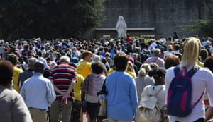 Worshippers leave after attending the Sunday mass in front of a reduced number of faithfuls due to sanitary measures, in the Saint Pie X Basilica in Lourdes, on 15 August, 2020, as part of the 147th Assumption pilgrimage.
