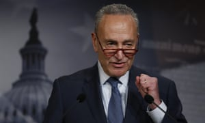 The Senate minority leader, Chuck Schumer, talks to reporters at the Capitol in Washington DC, on 16 January.