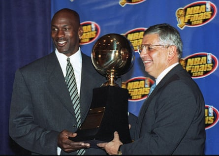 In a 1996 photo, Chicago Bulls' Michael Jordan receives the NBA finals MVP trophy from David Stern.