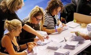Women count votes at the Emirates Stadium. Glasgow