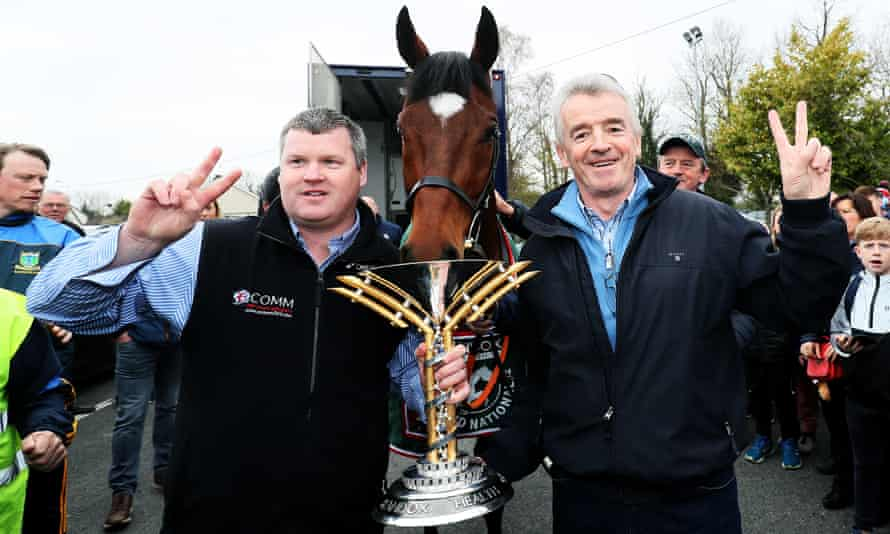 Grand National Winner Tiger Roll with trainer Gordon Elliott, left, and owner Michael O'Leary.