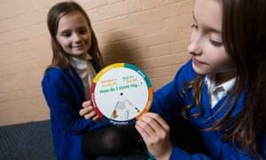 Woodville Junior School pupils Regen Phillpott, left, and Ella Robinson, check Sainsbury's 'Guide to how to store food'