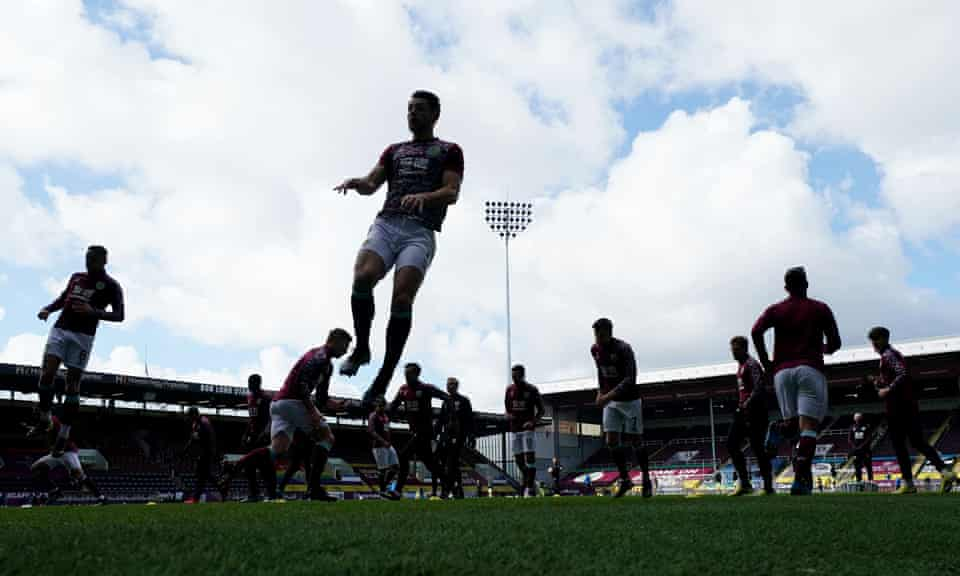 Burnley players warm up at Turf Moor. The team appeared to struggle without fans at their home ground last season.