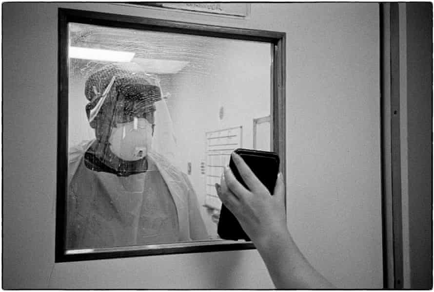 Showing a drug calculation formula on a phone screen during an infected emergency procedure