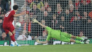 Curtis Jones of Liverpool puts the ball past Goalkeeper Emiliano Martinez of Arsenal.