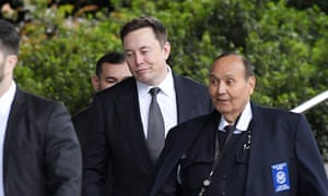 Elon Musk, second from right, arrives at US district court on Wednesday in Los Angeles.