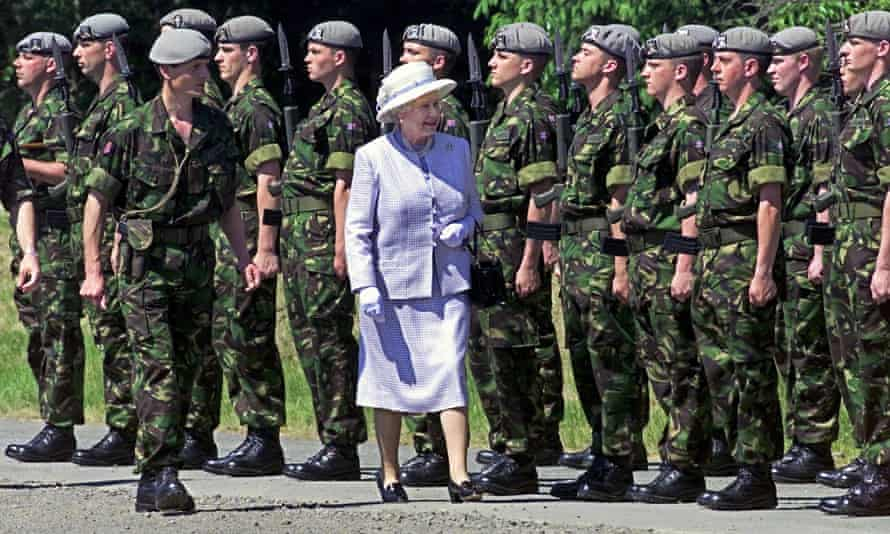 Inspecting the troops ... everyone who joins the army or RAF swears allegiance to the Queen, not the government of the day. Photograph: Rainer Jens/EPA