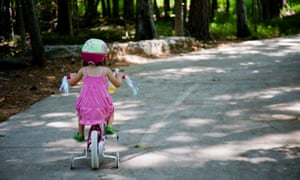 Child cycling on a road