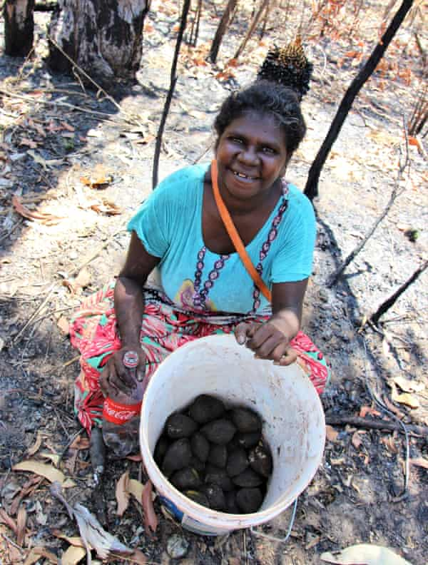 Joeleen Ganambarr with her haul of mud mussels from a day hunting with Miwatj s 4WD bus on Elcho Island.