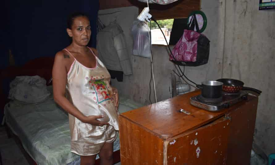 A pregnant resident of Boi Malhao in Zona Norte, São Paulo stands in her house