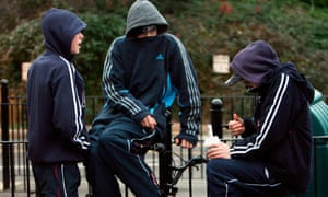 Young people in hooded tops