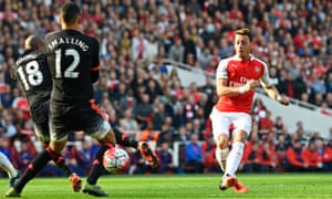 Mesut Ozil scores the second goal for Arsenal.