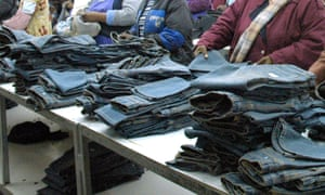 Workers make blue jeans in a factory in Lesotho