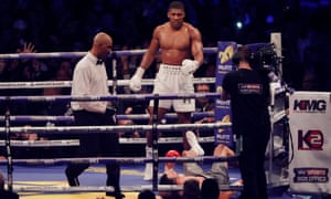 Anthony Joshua stands over Wladimir Klitschkoafter putting him on the canvas in the 11th round of their bout at Wembley Stadium.