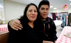 Catalina Vasquez Maldonado, 34, of El Salvador with her son Luis Carlos Pineda, 17, at Sacred Heart Catholic Church Center on 24 March 2016 in McAllen, Texas.