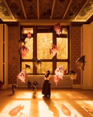 """Philippe Parreno's untitled show at Martin Gropius Bau in Berlin, won the award for best exhibition. Shown here is """"My room is another fish bowl"""", with dozens of inflated fish balloons floating freely in the space, and windows covered with yellow film"""