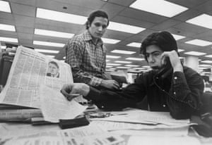 Bob Woodward and Carl Bernstein, Washington Post staff writers who have been investigating the Watergate case, at their desk in the Washington Post in 1973.