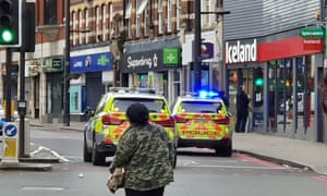 Police vehicles on Streatham High Road, south London