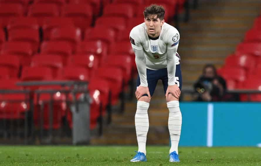 John Stones cuts a dejected figure after his error allowed Poland to equalise with England.