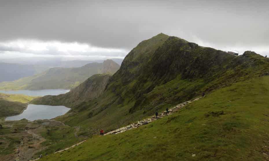 Walkers on the Pyg track up Snowdon, with the railway on the horizon.