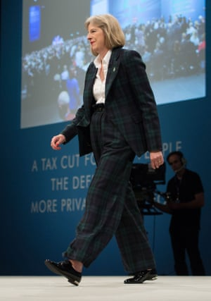 May addresses the Conservative party conference in Manchester in a tartan suit.