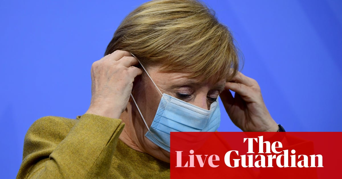 Coronavirus live news: Germany extends partial lockdown as world suffers record daily deaths – The Guardian
