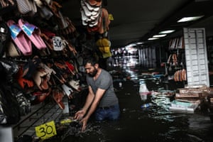 Sale items are soaked in flood water after heavy rain hit the tunnel underpass of Eminonu tram i