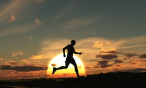 A man running at dawn is seen in silhouette