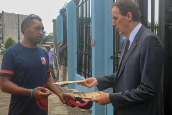 Former British Army medic Isei Vono presents a petition from Fijian soldiers who served in the British Army to the UK high commissioner to Fiji, George Edgar in Suva in September.