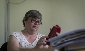 Jacquita Gonzales, 53, checks her mobile phone at her office in Kuala Lumpur, Malaysia on Thursday.
