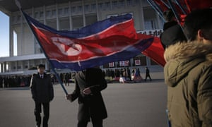 A North Korean man country's national flag