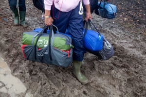 Wellie boots in the mud at Glastonbury Festival