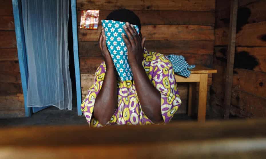 A woman covers her face in a centre for rape victims in the DRC