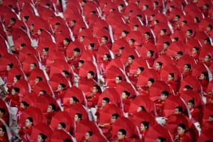 Participants create a sea of red umbrellas during the opening ceremony for the 13th Chinese National Games, Tianjin, China