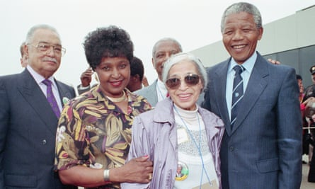 Winnie Madikizela-Mandela, second left, poses with her husband and the US civil rights campaigner Rosa Parks in 1990.