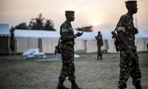 Soldiers patrol around marquees being built on the outskirts of Musaga, a neighbourhood in Bujumbura, on Monday. The marquees will be used as polling places.