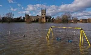 Tewkesbury Abbey and a children's playground at the confluence of the Rivers Severn and Avon on Friday.