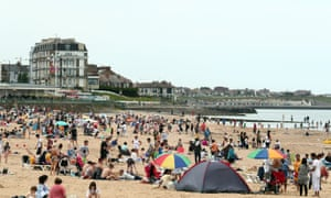 People enjoy the sun in Margate, Kent, on Sunday.