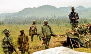 Soldiers of the Democratic Republic of the Congo stand guard near the border with Rwanda