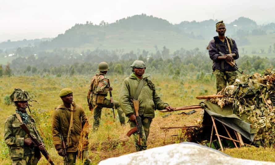 Democratic Republic of Congo soldiers stand guard near the border with Rwanda