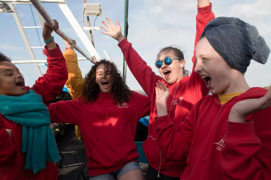 Sasha, Eve, Grace and Ruby celebrate as Amelie stands up on Cap Gris-Nez