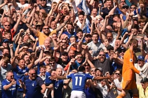 Theo Walcott celebrates with the Everton fans after scoring their fourth.