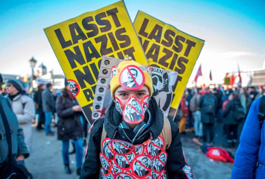 A protester with stickers depicting the new vice-chancellor of the far-right Freedom Party Christian Strache and incoming Austrian chancellor of the conservative People's Party Sebastian Kurz in Vienna last December.