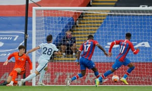 Palace's Christian Benteke (second right) slots the ball home.