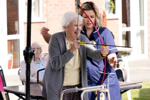 In the garden, a resident of the Amberwood Care Home has a go at archery.