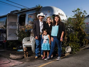 "Don Roberto Munoz, 40, and his family outside their classic Airstream trailer. Munoz says he chose to live at Buena Vista not just because it was affordable, but because of the friendliness of the multiracial community amid such a white and wealthy town. 'When we arrived here 11 years ago and saw this place I said, ""This is the place we are looking for""'<br><br>All Photographs: Winni Wintermeyer for the Guardian"