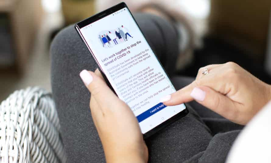 A woman installs the Covidsafe app
