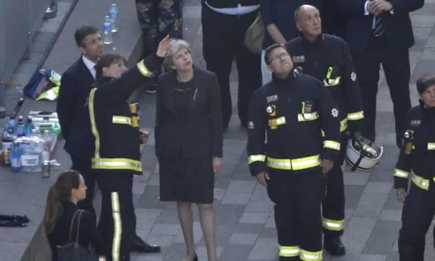 Theresa May speaks to Dany Cotton, the fire commissioner.