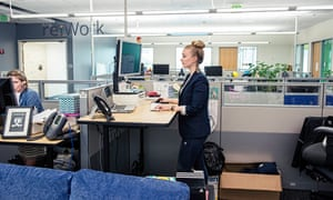 A Google employee works at her standing desk in Mountain View, California.